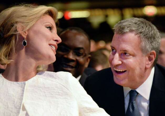 Gov. Andrew Cuomo's girlfriend Sandra Lee, left, and New York Mayor Bill de Blasio chat before the start of the State of the State address and budget proposal Wednesday Jan. 21, 2015, at the Empire State Plaza Convention Center in Albany, N.Y. (John Carl D'Annibale / Times Union) Photo: John Carl D'Annibale / 00030240B
