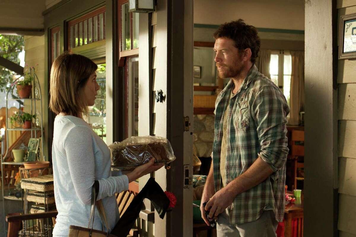"Jennifer Aniston and Sam Worthington in a scene from ""Cake."""