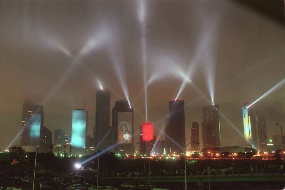 Laser beams and visual images were projected as high as 70 stories on several Houston skyscrapers. A stunning fireworks display accompanied the performance. Downtown Houston's laser show, 'Rendezvous Houston:  A City In Concert', at the Houston International Festival on April, 1986, featured Jean-Michel Jarre's music. Photo: Steve Ueckert, File  / Houston Chronicle