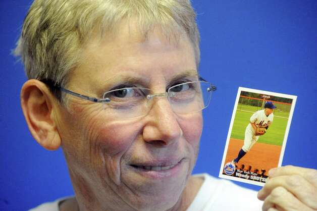Wendy Shotsky holds her 2014 player card from her time at the Mets fantasy camp on Tuesday Jan. 20, 2015 in Albany, N.Y. (Michael P. Farrell/Times Union) Photo: Michael P. Farrell / 00030270A