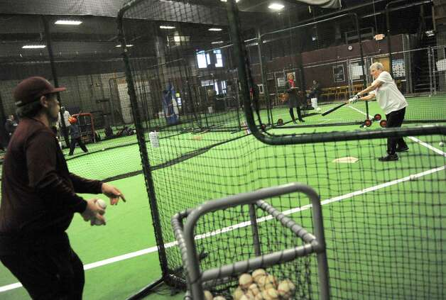 Wendy Shotsky, right, trains with Bill Farrell at Frozen Ropes baseball training facility on Tuesday Jan. 20, 2015 in Albany, N.Y. (Michael P. Farrell/Times Union) Photo: Michael P. Farrell / 00030270A