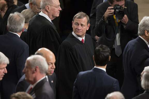 Supreme Court Chief Justice John Roberts waits for U.S. President Barack Obama, not pictured, to deliver the State of the Union address to a joint session of Congress at the Capitol in Washington, D.C., U.S., on Tuesday, Jan. 20, 2015. Obama declared the U.S. economy healed and said the nation now must begin work to close the gap between the well-off and the wanting. Photographer: Andrew Harrer/Bloomberg