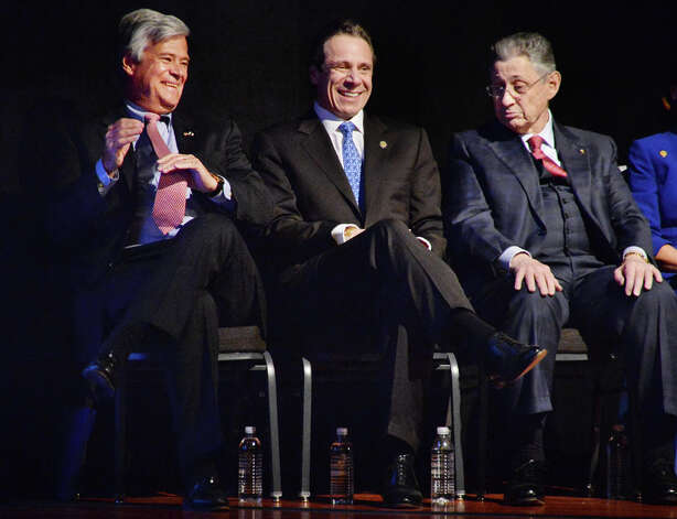 Senate majority leader Dean Skelos, left, Gov. Andrew Cuomo and Assembly Speaker Sheldon Silver share a laugh during the State of the State address and budget proposal Wednesday January 21, 2015, at the Empire State Plaza Convention Center in Albany, N.Y.   (John Carl D'Annibale / Times Union) Photo: John Carl D'Annibale, Albany Times Union / 00030240B