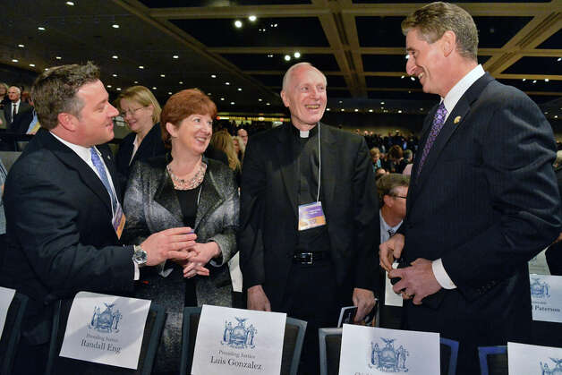 Albany Coounty Exeutive Daniel McCoy, left, Albany Mayor Kathy Sheehan, former Bishop Howard Hubbard and former Lt. Go. Bob Duffy, right, visit before Gov. Cuomo's State of the State address and budget proposal Wednesday January 21, 2015, at the Empire State Plaza Convention Center in Albany, NY.   (John Carl D'Annibale / Times Union) Photo: John Carl D'Annibale, Albany Times Union / 00030240B