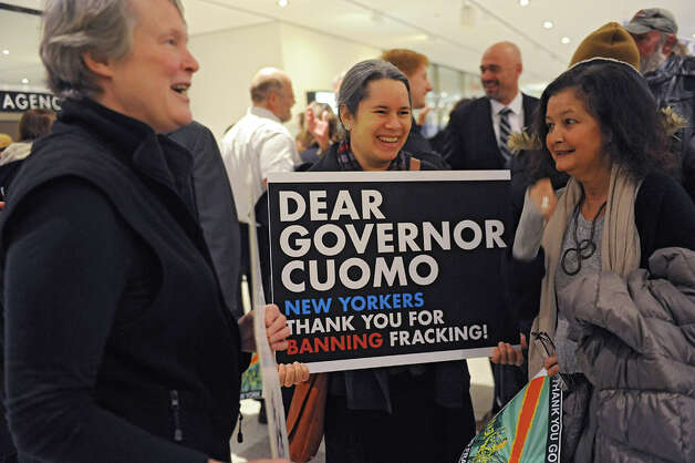 Singer-songwriter and activist Natalie Merchant, center, was among many people holding signs thanking Governor Andrew Cuomo for banning fracking before his State of the State address in the Convention Center at the Empire State Plaza on Wednesday, Jan. 21, 2015 in Albany, N.Y.  (Lori Van Buren / Times Union) Photo: Lori Van Buren, Albany Times Union / 00030240A
