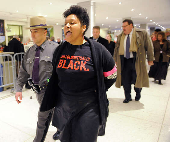 Protestors are arrested for blocking the entrance to Governor Andrew Cuomo's State of the State address in the Convention Center Wednesday, Jan. 21, 2015, at Empire State Plaza in Albany, N.Y. Most of the protestors were chanting about police brutality against black people. (Lori Van Buren / Times Union) Photo: Lori Van Buren, Albany Times Union / 00030240A