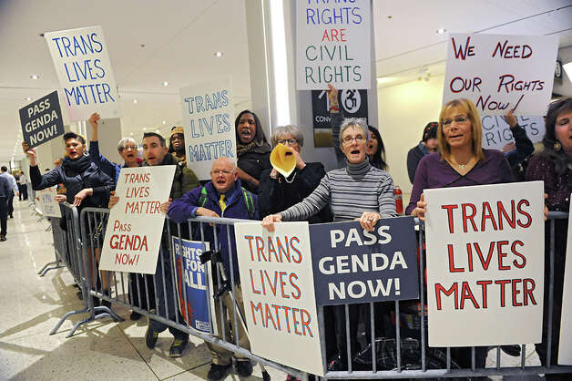 Protestors for transgender rights are kept behind barriers outside the entrance to Governor Andrew Cuomo's State of the State address event in the Convention Center at the Empire State Plaza on Wednesday, Jan. 21, 2015 in Albany, N.Y. (Lori Van Buren / Times Union) Photo: Lori Van Buren, Albany Times Union / 00030240A