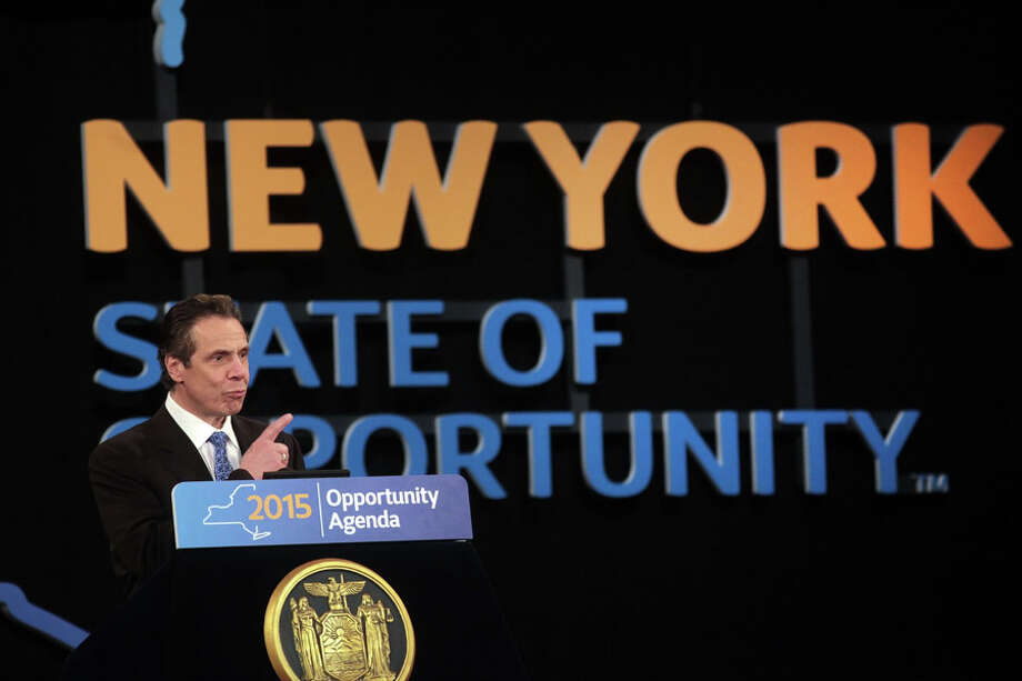 Gov. Andrew Cuomo delivers his 2015 State of the State address, in Albany, N.Y., Jan. 21, 2015. In a speech that doubled as a yearly budget outline, Cuomo called on New York lawmakers to control taxes and spending while simultaneously addressing income inequality, educational reforms and upstate fiscal woes. (Nathaniel Brooks/The New York Times) ORG XMIT: XNYT43 Photo: NATHANIEL BROOKS, New York Times / NYTNS