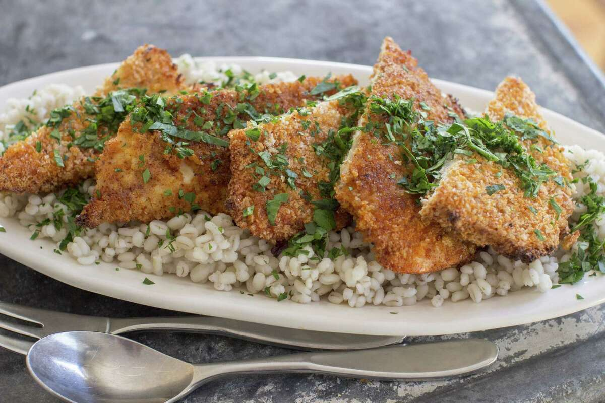 This Jan. 5, 2015, photo shows sweet-and-spicy panko-crusted chicken in Concord, N.H. While the breaded cutlets can be pan-fried, you can also use the ease of the oven. (AP Photo/Matthew Mead) ORG XMIT: MER2015011606451171