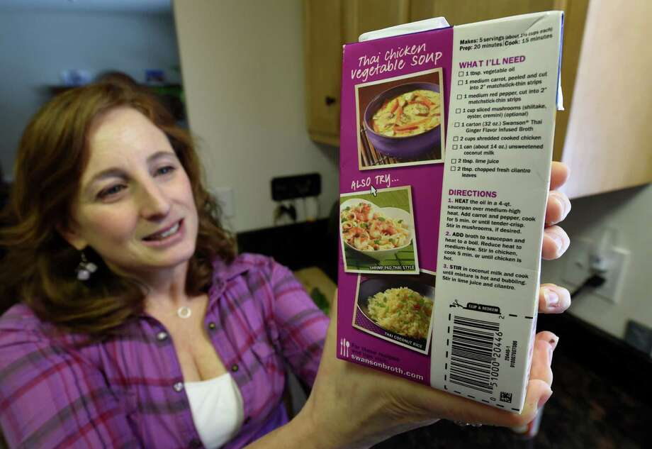 Carrie Bernardi holds up the box from which she will prepareThai chicken vegetable soup Monday afternoon, Jan. 19, 2015, in Slingerlands, N.Y.     (Skip Dickstein/Times Union) Photo: SKIP DICKSTEIN / 00030243A