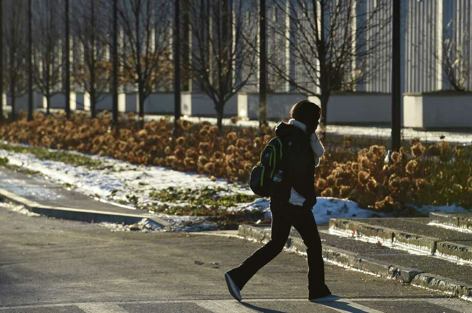 Students arrive for the start of the spring semester at the University at Albany Wednesday morning, Jan. 21, 2015 in Albany, N.Y. (Skip Dickstein/Times Union) Photo: SKIP DICKSTEIN / 00030167A