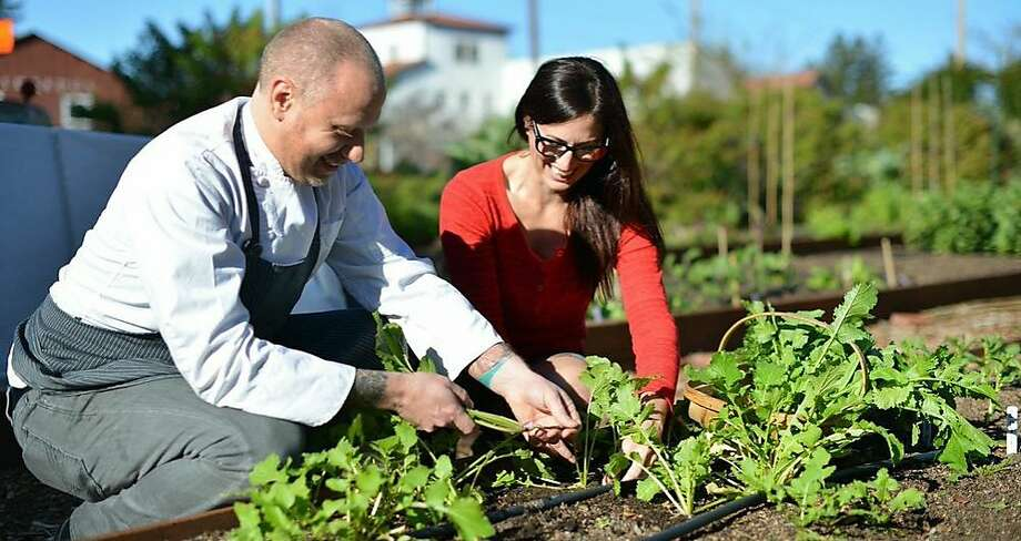 Kyle Connaughton and Katina Connaughton work in the garden that will supply many ingredients for the dishes in their new restaurant. Photo: Sally Egan
