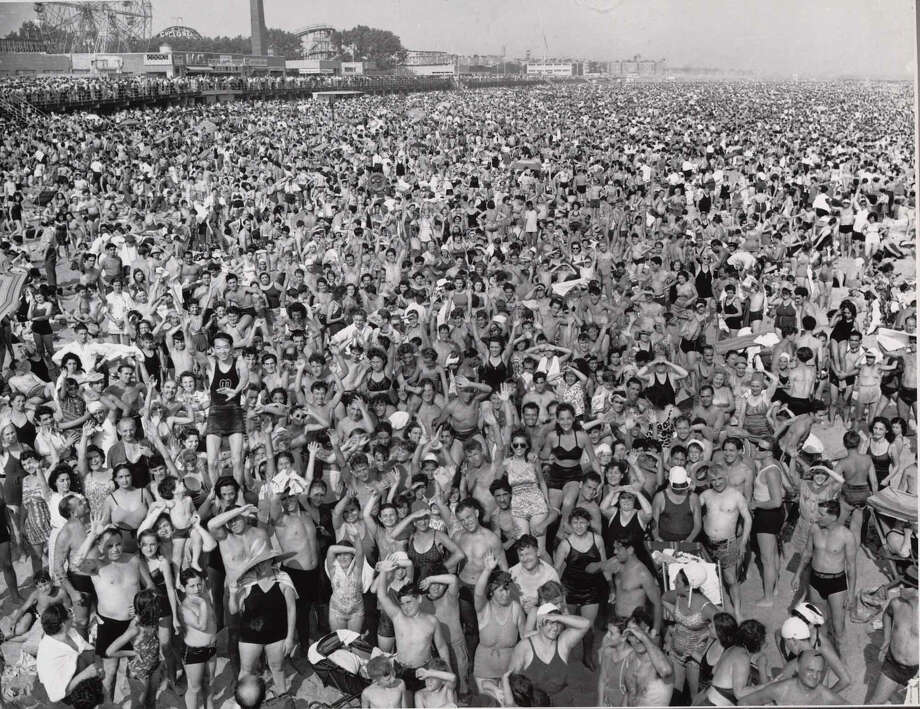 "ìConey Island"" by Weegee (a pseudonym for Arthur Fellig) was shot in 1940. It is one of more than 50 Coney Island images on display in a show at the Westport Arts Center. Westport CT. January 2015. Photo: Westport News/Contributed Photo / Westport News"