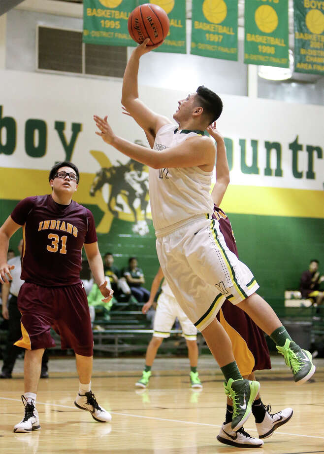 McCollum's Danny Lerma hits a shot with 13 seconds remaining in the game to give the Cowboys a 52-50 victory over Harlandale during their game at McCollum on Friday, Jan. 16, 2015.  MARVIN PFEIFFER/ mpfeiffer@express-news.net Photo: Marvin Pfeiffer, Staff / San Antonio Express-News / Express-News 2015