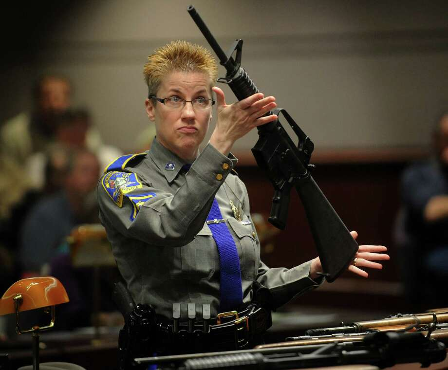 State police Detective Barbara Mattson displays a Bushmaster assault-style rifle, the type used in the Sandy Hook School shooting, during testimony before the Gun Violence Prevention Working Group at the Legislative Office Building in Hartford, Conn. on Monday, January 28, 2013. Photo: Brian A. Pounds / Connecticut Post