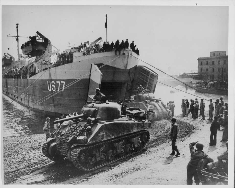 US troops of the 5th Army, 1st Division, loading tanks onto land from naval ships during World War Two, prior to the Battle of Anzio, Italy, 1944. Photo: A. E. French, Getty Images / 2013 Getty Images