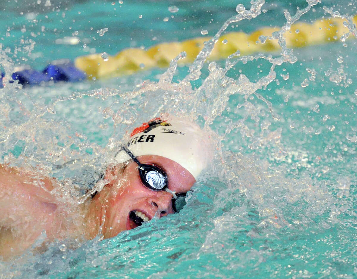 Thomas Dillinger of Greenwich competes in the 200 freestyle event that he won during the high school swim meet between Greenwich High School and Darien High School at the YMCA of Darien, Conn., Wednesday, Jan. 21, 2015. The final score of the swim meet was Greenwich 109, Darien 74.
