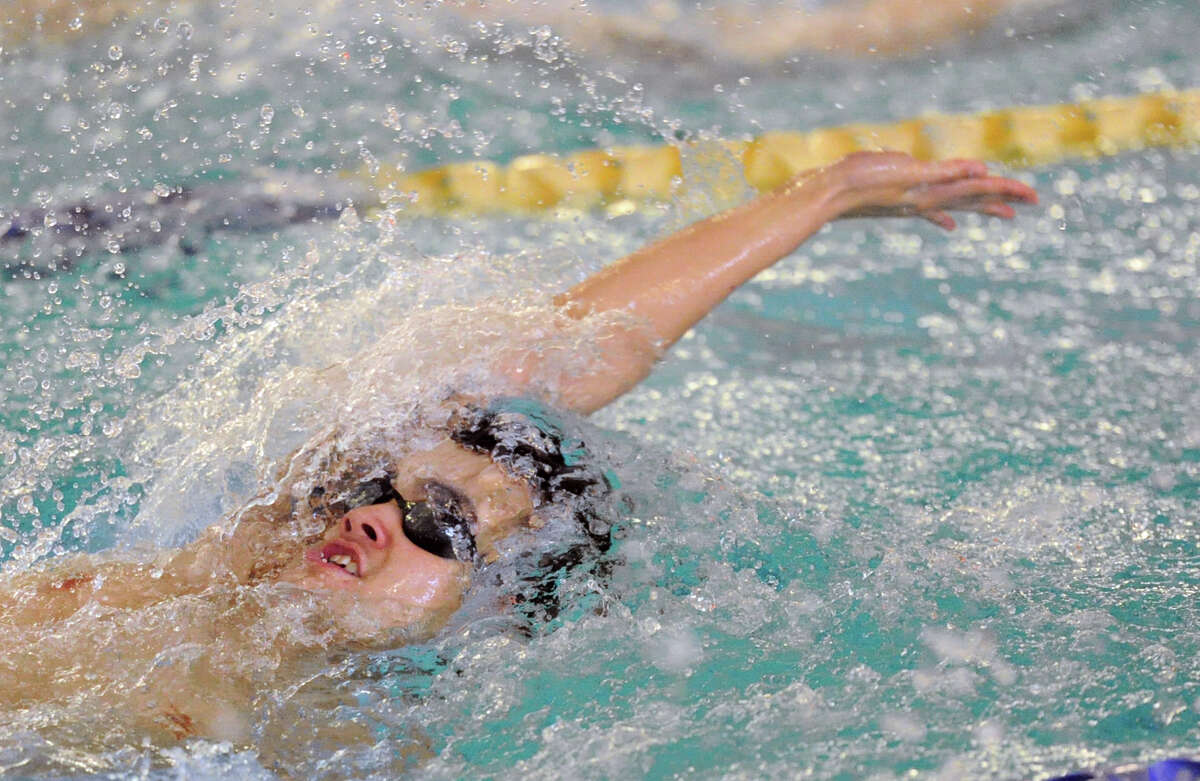 Nick Handali of Greenwich does the backstroke during the 200 medley relay event in the high school swim meet between Greenwich High School and Darien High School at the YMCA of Darien, Conn., Wednesday, Jan. 21, 2015. The final score of the swim meet was Greenwich 109, Darien 74.