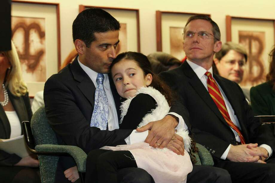 Bexar County District Attorney Nicholas LaHood kisses his daughter, Maya, before taking his oath of office on Jan. 1. A reader says he is tired or reading negative commentary about LaHood in the Express-News. Photo: Kin Man Hui /San Antonio Express-News / ©2014 San Antonio Express-News