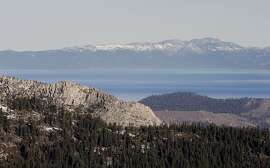 Mountains around Lake Tahoe show very little snow as viewed from the Sierra at Tahoe Ski Resort near Echo Summit, Ca., on Wednesday January, 21, 2015.