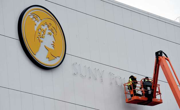 Workers install hardware, Thursday afternoon Dec. 18, 2014, for the letters that will spell out SUNY Polytechnic Institute on the side of the new nano engineering building in Albany, N.Y.    (Skip Dickstein/Times Union)