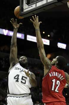 Spurs' DeJuan Blair (45) shoots over Portland Trailblazers' LaMarcus Aldridge (12) in the first half at the AT&T Center on Wednesday, Dec. 23, 2009. Photo: KIN MAN HUI, San Antonio Express-News