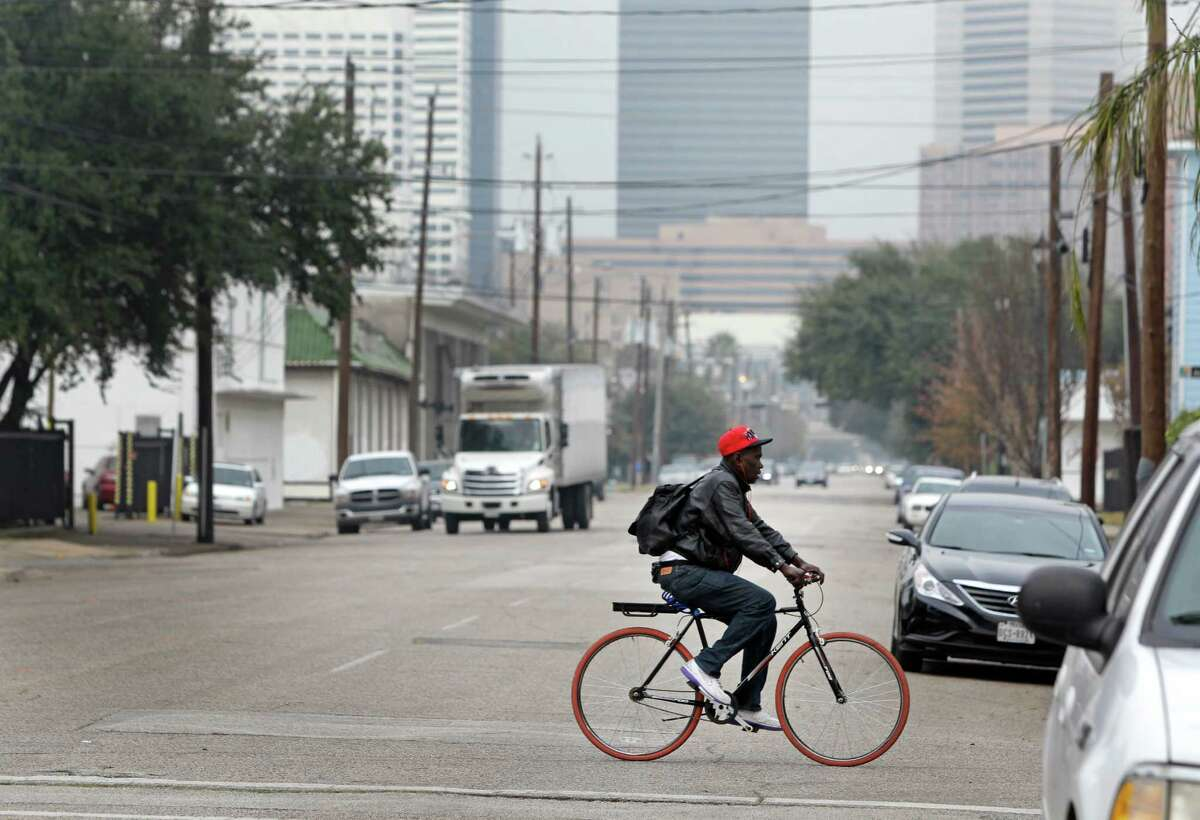 View along Caroline Street near Elgin looking towards downtown shown Wednesday, Jan. 21, 2015, in Houston. Midtown officials have plans to redesign Caroline Street to make it more appealing, with bikes lanes and trees and on-street designated parking.
