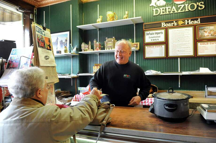 Business owner Rocco DeFazio, right, assists Lois Teitsch, a customer since 1965, on Wednesday, Jan. 21, 2015, at DeFazio's Deli in Troy, N.Y. (Cindy Schultz / Times Union) Photo: Cindy Schultz