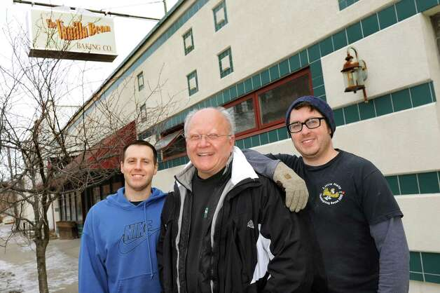 Rocco DeFazio, center, and his sons Matthew, left, and Michael stand in front of the future location of their family business, DeFazio's, on Wednesday, Jan. 21, 2015, in Troy, N.Y. (Cindy Schultz / Times Union) Photo: Cindy Schultz