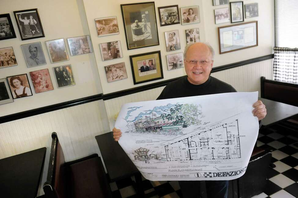 Rocco DeFazio holds the plans for the future family business on Wednesday, Jan. 21, 2015, at DeFazio's Pizzeria in Troy, N.Y. (Cindy Schultz / Times Union)