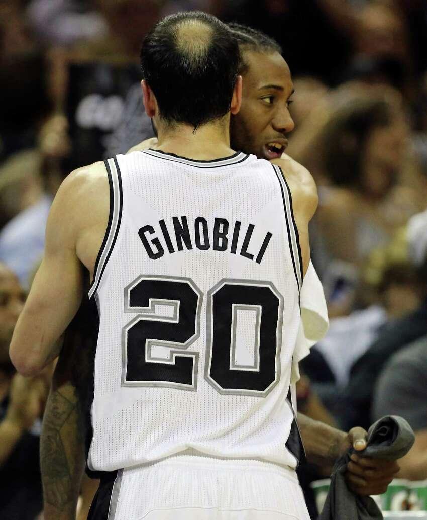 This one-sided Manu Ginobili-Kawhi Leonard hug late in Game 5 of the 2014 NBA Finals. Kawhi's just shy.