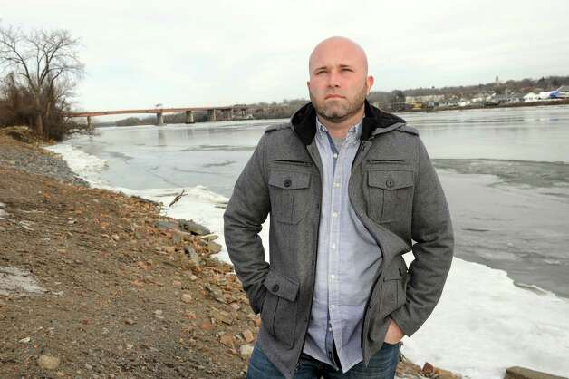 Joe Martin, owner of Springer's Welding, stands at the future site of Springer's Marina along the Hudson River on Wednesday, Jan. 21, 2015, in Albany, N.Y. (Cindy Schultz / Times Union) Photo: Cindy Schultz / 00030284A