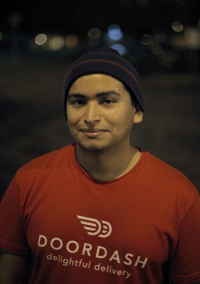 Eli (declined to have last name used) in Campbell, Calif., on Tuesday, January 20, 2015. Eli drives for DoorDash, a food delivery service in addition to Lyft and Uber, and is glad to have the Intuit financial management software for self-employed people. Photo: Carlos Avila Gonzalez / The Chronicle / ONLINE_YES