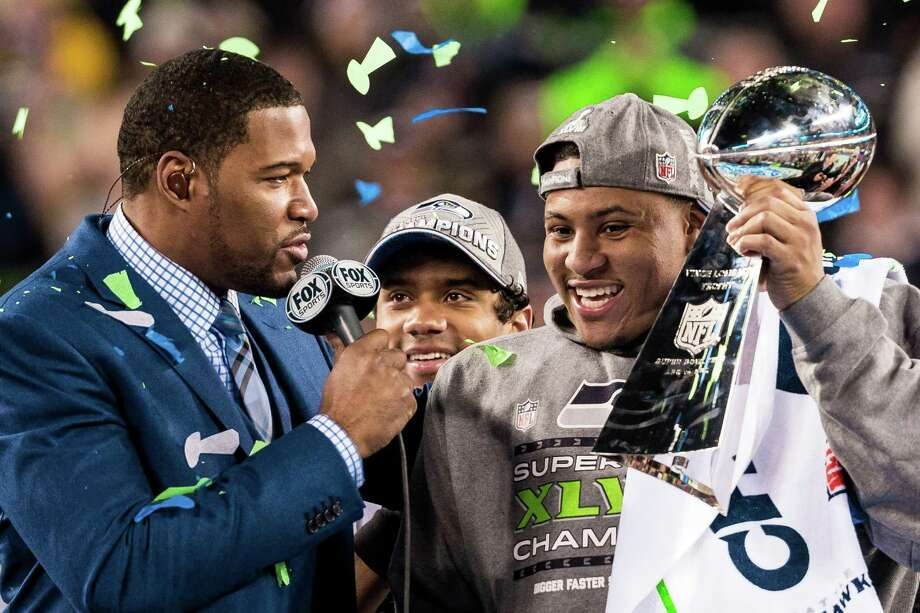 Seahawks hoist the Lombardi trophy following the Seahawks victory over the Broncos during Super Bowl XLVIII Sunday, Feb. 2, 2014, at MetLife Stadium in New Jersey. The Seahawks beat the Broncos 43 - 8 to clinch the championship. This is the first time these photos have been published. Click here to see what we did previously publish from the game. Photo: JORDAN STEAD, SEATTLEPI.COM / SEATTLEPI.COM