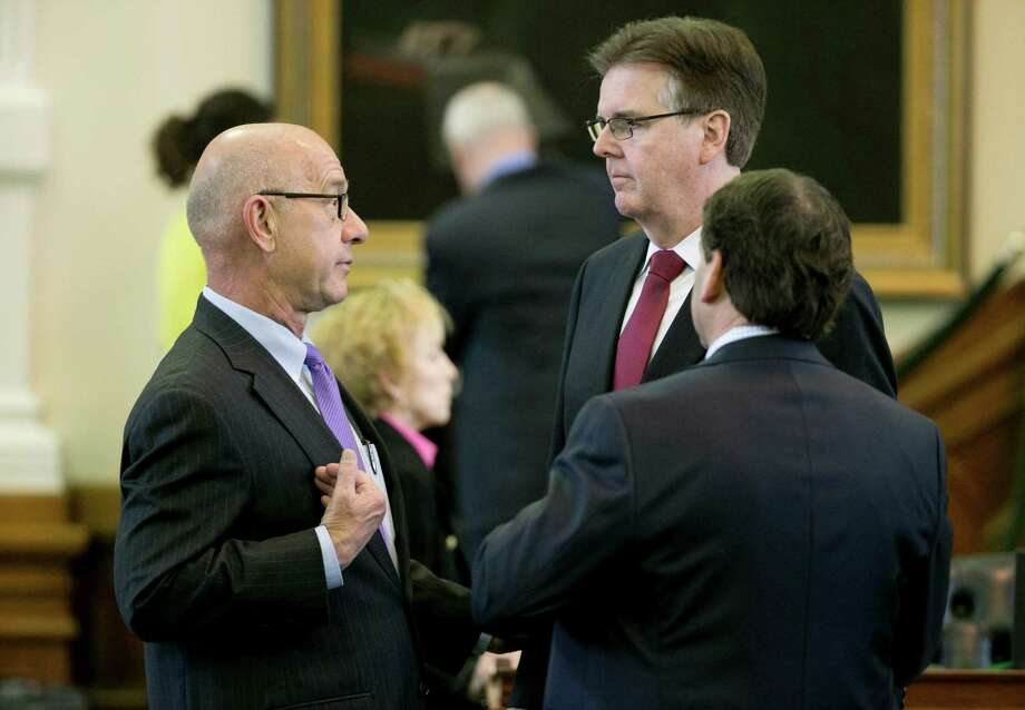 Sen. John Whitmire, left, talks to Lt. Gov. Dan Patrick, center, and Sen. Kevin Eltife after new senate rules were adopted in the Senate Chamber at the Capitol in Austin on Jan. 21. (AP Photo) Photo: Jay Janner, MBO / Austin American-Statesman