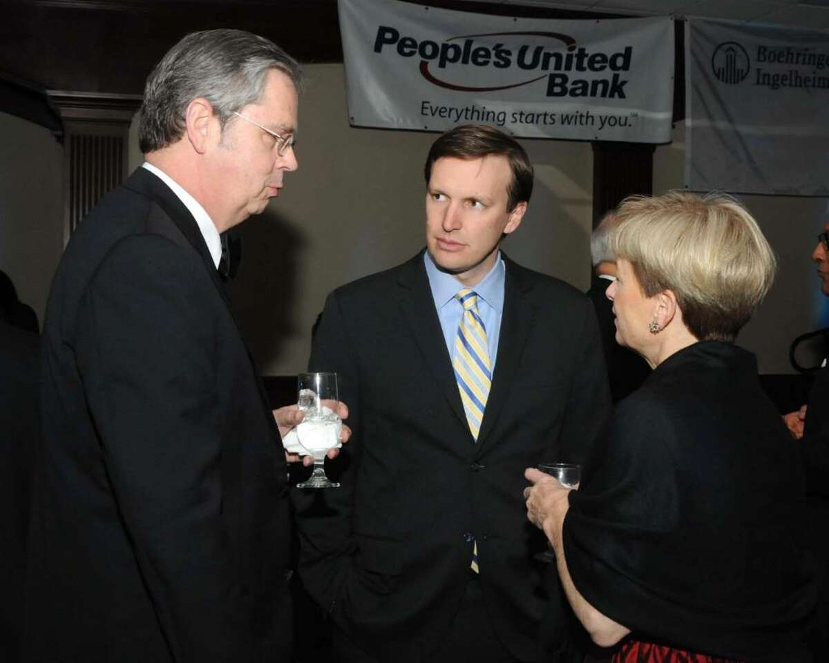 The 2010 Hord Foundation Charity Ball was held at the Amber Room Colonnade in Danbury, CT on Saturday Feb. 27. From left, Attorney Paul Luz of Newtown, Congressman Christopher Murphy and Cate Lux of Newtown converse at the Gala.