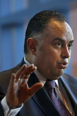 John A. Perez talks to the media during a lunch break from the UC regents board meeting in San Francisco on Wednesday.