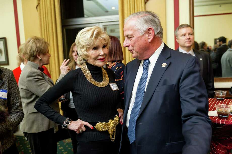 """Houston socialite Joanne Herring, the real life Julia Roberts character in """"Charlie Wilson's War,"""" talks with Rep. Gene Green, D-Tex., 29th Dist., who is sponsoring a bill to award the Congressional Gold Medal to Herring, former Texas congressman the late Charlie Wilson and the late CIA agent Gustav Avrakatos, for their efforts to supply weapons to the Afghan Mujahideen in their fight against the Soviet Union in the 1980's. The two talked during a reception for Herring in the Gold Room of the Rayburn House Office Building on Capitol Hill in Washington, D.C., on Wednesday, January 21, 2013. Photo: J.M. EDDINS, JR., FOR THE CHRONICLE / HOUSTON CHRONICLE"""