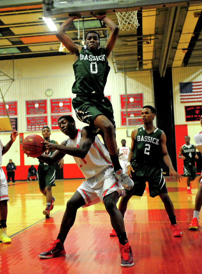 Bassick's Kiante Smith goes up and over to block Central's Joaquim Johnson as he tries to score under the basket, during boys basketball action in Bridgeport, Conn. on Wednesday Jan. 21, 2015. Photo: Christian Abraham / Connecticut Post