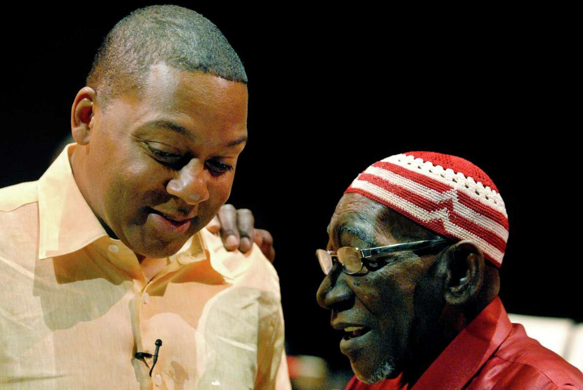 ALBANY TIMES UNION STAFF PHOTO--MICHAEL P. FARRELL Jazz trumpeter and leader of the Lincoln Center Jazz Orchestra Wynton Marsalis (left) confers with Ghanaian drum master Yacub Addy of Latham, New York on a piece they colaborated on titled