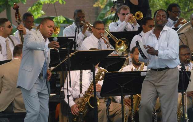 "ALBANY TIMES UNION STAFF PHOTO--MICHAEL P. FARRELL--Jazz trunpeter  and leader of the Lincoln Center Jazz Orchestra Wynton Marsalis (left)  during the opening of the world premere of ""Conga Square ""  he colaberated on with Ghanaian drum master Yacub Addy at Louis Armstrong Park in New Orleans , LA Sunday April 23, 2006. Photo: MICHAEL P. FARRELL / ALBANY TIMES UNION"