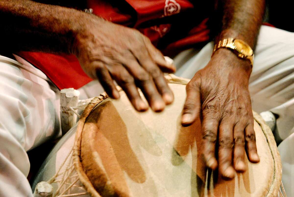 KATRINA RECOVERY-- NEW ORLEANS RECOVERY---- Ghanaian drum master Yacub Addy of Latam, New York drums on piece he colaborated with Jazz trunpeter and leader of the Lincoln Center Jazz Orchestra Wynton Marsalis titled