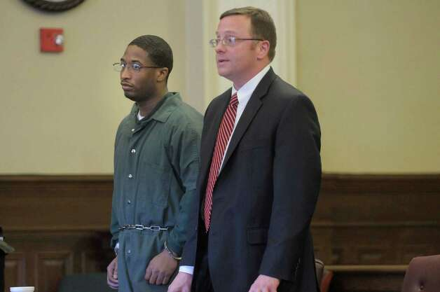 Paul Walker, left, who was found guilty last month of attempting to kill a pizza parlor worker who was trying to foil a robbery attempt, and his lawyer, Michael Mansion, right, stand during Walker's sentencing in Judge Andrew Ceresia's courtroom at the Rensselaer County Courthouse in Troy, NY on Thursday, Jan. 6, 2011.    (Paul Buckowski / Times Union) Photo: Paul Buckowski / 00011657A