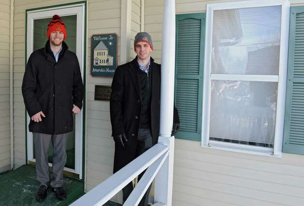Adirondack Flames Director of Communications Zach Dooley, left, and Cameron Close, play-by-play broadcaster, stand outside of Amanda's House on Wednesday, Jan. 14, 2015 in Glens Falls, N.Y. The Adirondack Flames are in the middle of a 30-day fundraising campaign, in partnership with the Adirondack Regional Chamber of Commerce Leadership Group, to benefit the renovation of Amanda's House. (Lori Van Buren / Times Union) Photo: Lori Van Buren / 00030200A