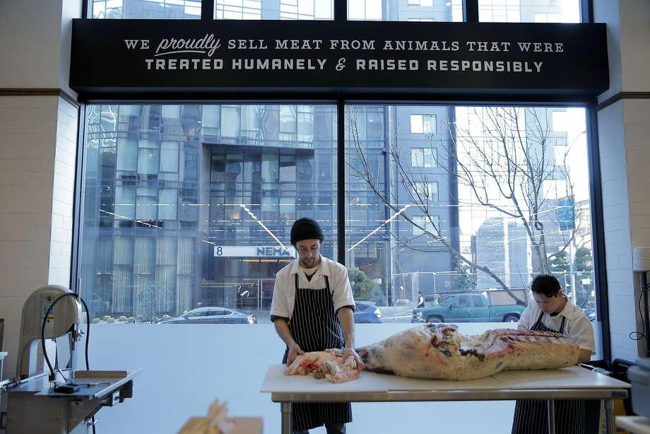 Rachel Denning and JT Sagundes, left, butcher a side of beef at The Market, a new marketplace on Market Street on the ground floor of the Twitter building in San Francisco, Calif., on Tuesday, January 20, 2015. It is divided into different areas: grocery, meat, fish, flowers, etc. Photo: Carlos Avila Gonzalez, The Chronicle