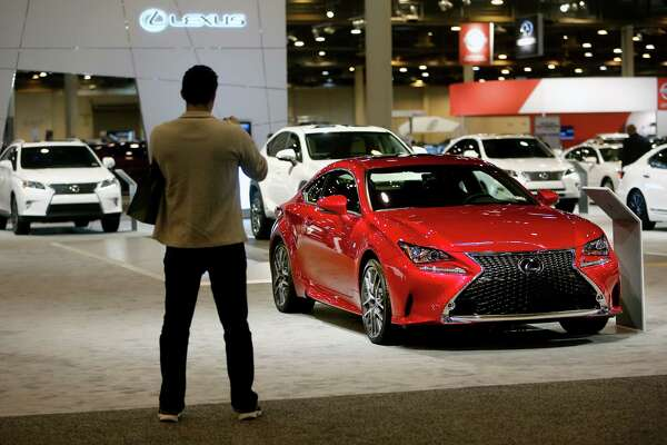 Randy Kiser, of Altair Engineer and Design, with a Lexus RC 350 F Sport RWD at the 2015 Houston Auto Show at NRG Center Wednesday, Jan. 21, 2015, in Houston, Texas. ( Gary Coronado / Houston Chronicle )