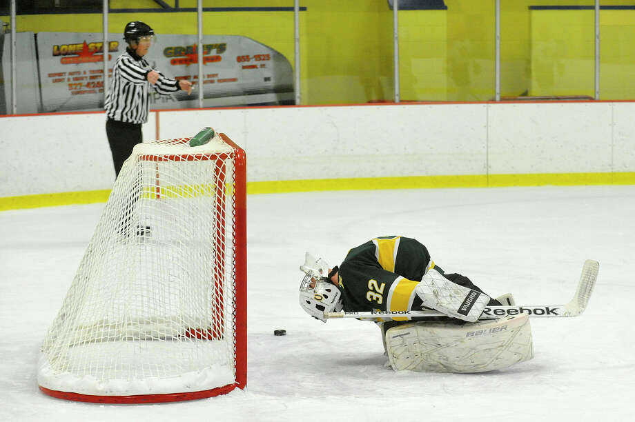 Trinity Catholic goalie  PJ Duddie reacts after Westhill scored their fourth goal during their hockey game at Terry Conners Rink in Stamford, Conn., on Wednesday, Jan. 21, 2015. Westhill won, 9-1. Photo: Jason Rearick / Stamford Advocate