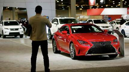 Randy Kiser, of Altair Engineer and Design, with a Lexus RC 350 F Sport RWD at the 2015 Houston Auto Show at NRG Center Wednesday, Jan. 21, 2015, in Houston, Texas.