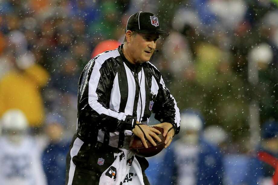 FOXBORO, MA - JANUARY 18:  Umpire Carl Paganelli #124 holds a ball on the field after a play during the 2015 AFC Championship Game between the New England Patriots and the Indianapolis Colts at Gillette Stadium on January 18, 2015 in Foxboro, Massachusetts.  It was reported on January 19, 20015 that the league is looking into the apparent use of deflated footballs by the New England Patriots during their game.  (Photo by Elsa/Getty Images) ORG XMIT: 532632539 Photo: Elsa / 2015 Getty Images