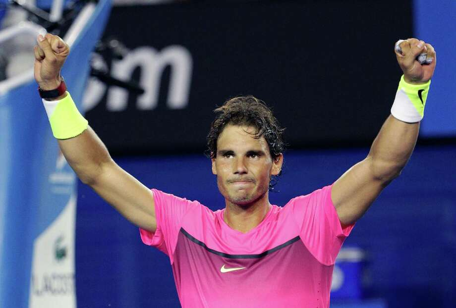 Rafael Nadal of Spain celebrates after defeating Tim Smyczek of the U.S. during their second round match at the Australian Open tennis championship in Melbourne, Australia, Wednesday, Jan. 21, 2015. (AP Photo/Rob Griffith) ORG XMIT: MEL412 Photo: Rob Griffith / AP